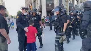Tender moment caught on camera of police chief helping a young boy, who was scared at protest