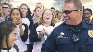 Massive mob overwhelms school's favorite police officer!