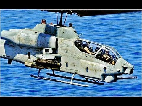 US Military AH-1W SUPER COBRA pilots flying in Military exercise