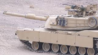 4th Tank Battalion Marines demonstrate tank crewman positions in the M1A1 Abrams tan