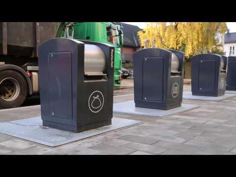 Hvordan tømmes en nedgravd søppelcontainer?