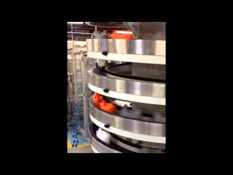 AmbaFlex Spiral Conveyor - Empty puck handling single file