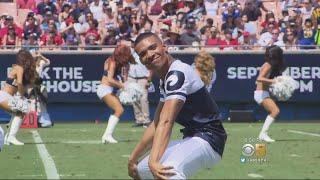 Male Dancers Join Women Cheerleaders On Sidelines At NFL Games