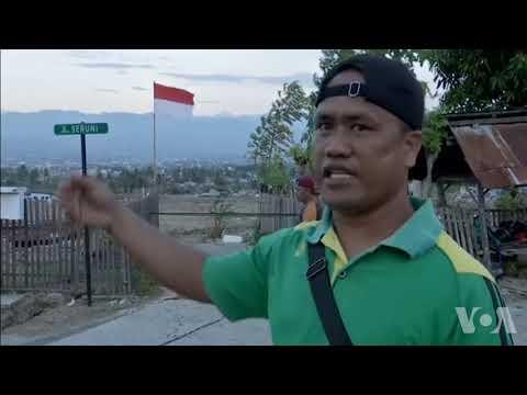印尼开始大批埋葬地震海啸遇难者
