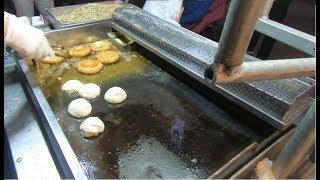 [South Korea:Busan] Street food sweet Korean pancake stuffed with seeds