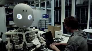 ROBOY: Humanoid Robot singing & having fun!  Roboy and one of his engineers working at the lab and have some fun.