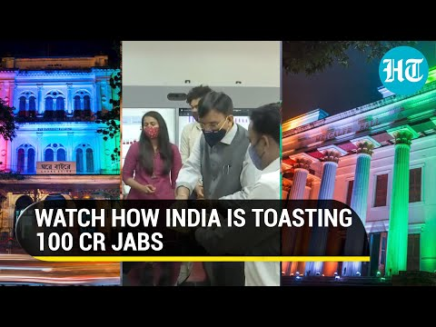 India lights up to celebrate 100 crore Covid jabs, Mansukh Mandaviya distributes sweets