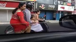 small child driving scooty infront of kochi lulu mall