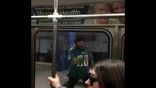 Eagles Fan gets rowdy with subway passengers chasing the train and runs face first into pole