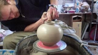 Throwing a spherical round Korean type pottery Vase on the wheel