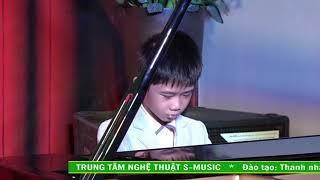 doc-tau-piano-bieu-dien-bao-cao