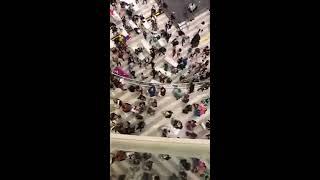 Santa throws 1000 $1 bills from Mall of America balcony