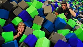 HIDE AND SEEK IN 100,000 FOAM PIT CUBES!! *Ninja Warrior Trampoline Park Challenge*