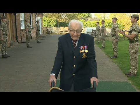 WWII veteran Captain Tom Moore completes his 100th lap after raising over £12m for the NHS