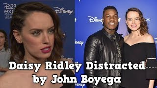 Daisy Ridley Distracted by John Boyega During D23 Interview!