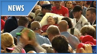 Trump rally crowd sing for passed-out supporter