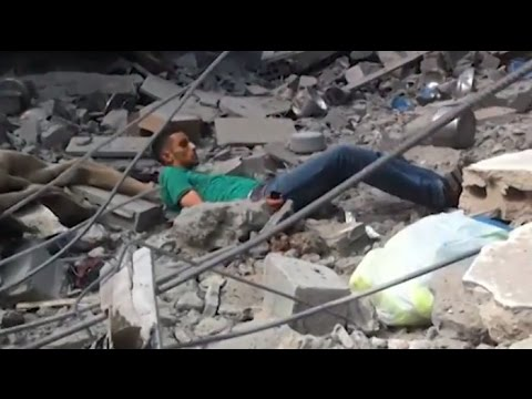 Gaza Video of Civilian Shot By Israeli Sniper + Iron Dome In Action - TheLipTV  - WD4pSfd8gP4 -