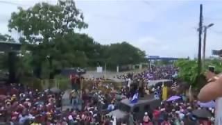 Migrants break through fence at Guatemala Mexico border