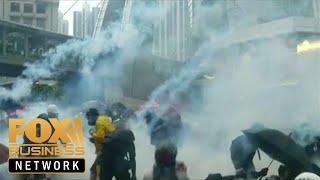 Hong Kong protests turn violent as police fire live ammunition