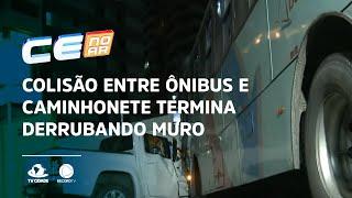 Colisão entre ônibus e caminhonete termina derrubando muro de condomínio
