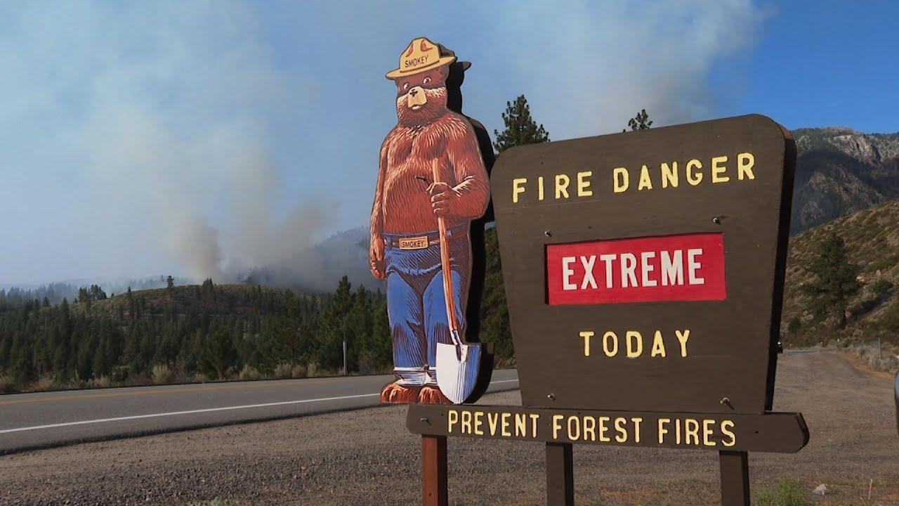 Growing California wildfire spreads into Nevada