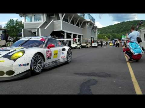 Cars roll through the paddock at Lime Rock Park