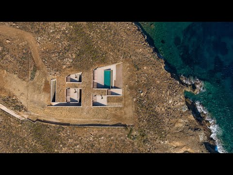 """Mold Architects completes """"cave-like"""" house overlooking the Mediterranean Sea"""