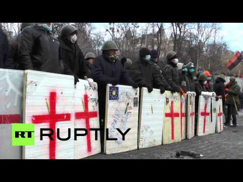 Protesters in Kiev face off against riot police with road cobbles