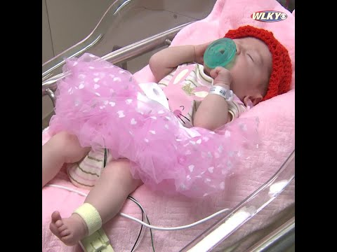 Babies at Baptist Health wear red hats for National Heart Month