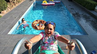 WATER SLIDE IN OUR SWIMMING POOL!!