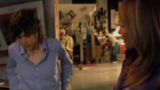 Rosanna Arquette with purple satin blouse