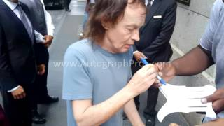 AC/DC Angus Young Signing Autographed Guitar n Pickguards in NYC for AutographPros