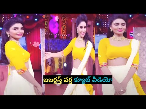 Jabardasth Varsha in traditional wear with mysterious tattoo on back