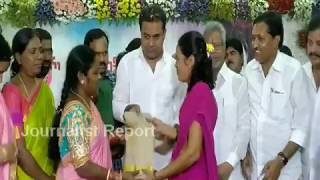 KTR distributing Bathukamma sarees to women..