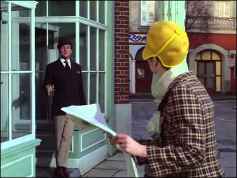 Youtube video - Mrs Peel buys the morning paper, only to discover the front page now reads 'Mrs Peel - we're needed!' as Steed smirks at her from a nearby doorway