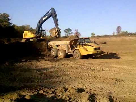 BLUE STAR CONSTRUCTION - John Deere 450D Excavator Loading CAT 740 Rock Trucks