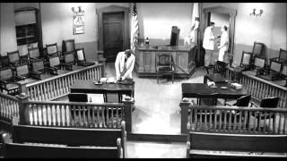 Atticus Finch walks out of the court after Tom Robinson is found guilty