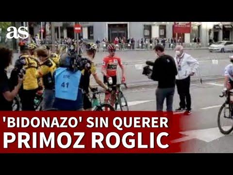 Primoz Roglic lanza un bidón de regalo en Madrid y le da a un policía   Diario AS