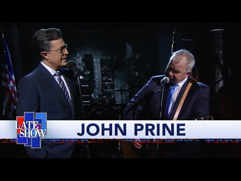 "John Prine And Stephen Colbert: ""That's the Way the World goes Round"""