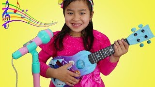 Jannie Plays with Disney Frozen Toy Guitar and Starts a Band