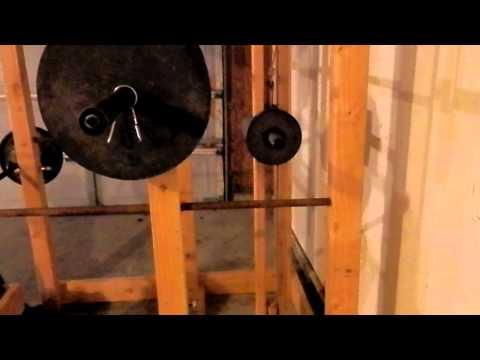 Homemade squat rack musica movil for Homemade safety squat bar