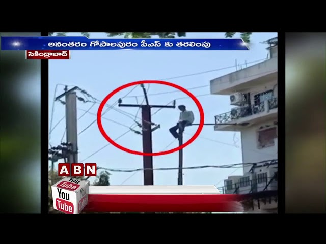 Man Climbs Electric Pole,Police Brought Down After An Hour At Secunderabad | ABN Telugu