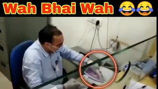 Viral video: Banker uses steam Iron to disinfect cheque..