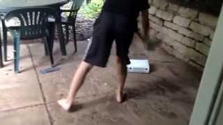 Kid breaks Xbox over rage