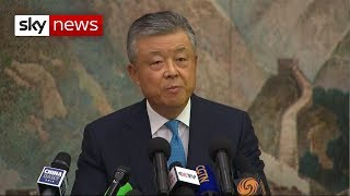 China 'will not sit on its hands' over Hong Kong protests