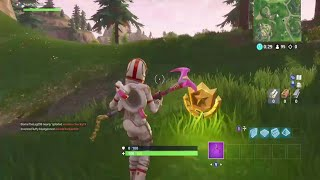 Search between a gas station, soccer pitch, and stunt mountain Fortnite secret tier