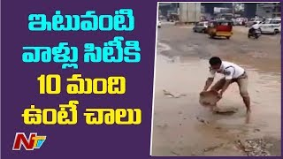 Inspiring Video: Traffic Police Clears Rain Water On Road..