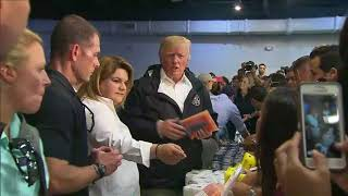 Trump throws paper towel rolls into crowd while delivering aid supplies in Puerto Rico