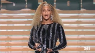 Beyonce presents Colin Kaepernick with the Sports Illustrated's Muhammad Ali Legacy Award