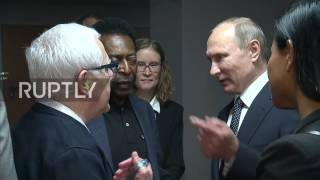 Russia: Putin meets with footballing legend Pele during Russia's win over New Zealand